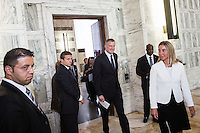 ROME, ITALY - 21 JULY 2014:  (L-R) Mayor of New York Bill De Blasio steps outside a meeting room for a conference press conference with Italian Minister of Foreign Affairs Federica Mogherini, at the  Ministry of Foreign Affairs, in Rome, Italy, on July 21st 2014.<br /> <br /> New York City Mayor Bill de Blasio arrived in Italy with his family Sunday morning for an 8-day summer vacation that includes meetings with government officials and sightseeing in his ancestral homeland.