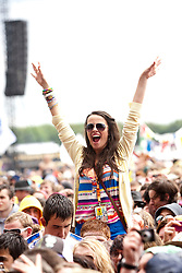 Fans in the rain as Kesha plays the main stage..T in the Park on Saturday 9th July 2011. T in the Park 2011 music festival takes place from 7-10th July 2011 in Balado, Fife, Scotland..©Pic : Michael Schofield.