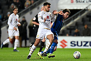 Milton Keynes Dons forward Sam Nombe (27) battles for possession  with Rochdale midfielder Oliver Rathbone (14) during the EFL Sky Bet League 1 match between Milton Keynes Dons and Rochdale at stadium:mk, Milton Keynes, England on 28 January 2020.