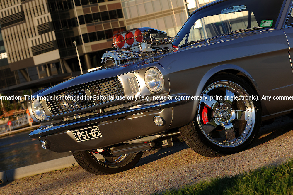 1965 Ford Mustang Coupe - Silver.Port Melbourne, Melbourne, Victoria.5th of November 2010.(C) Joel Strickland Photographics.Use information: This image is intended for Editorial use only (e.g. news or commentary, print or electronic). Any commercial or promotional use requires additional clearance.