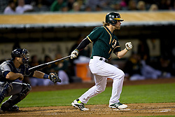 OAKLAND, CA - APRIL 03:  Josh Reddick #16 of the Oakland Athletics of the Oakland Athletics at bat against the Seattle Mariners during the second inning at O.co Coliseum on April 3, 2014 in Oakland, California. The Oakland Athletics defeated the Seattle Mariners 3-2 in 12 innings.  (Photo by Jason O. Watson/Getty Images) *** Local Caption *** Josh Reddick