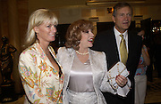 Joan Collins and Mr. and Mrs. Charles Delevigne, pay tribute to Joan Collins at a  lunch  at The Dorchester. 14th May 2004. ONE TIME USE ONLY - DO NOT ARCHIVE  © Copyright Photograph by Dafydd Jones 66 Stockwell Park Rd. London SW9 0DA Tel 020 7733 0108 www.dafjones.com