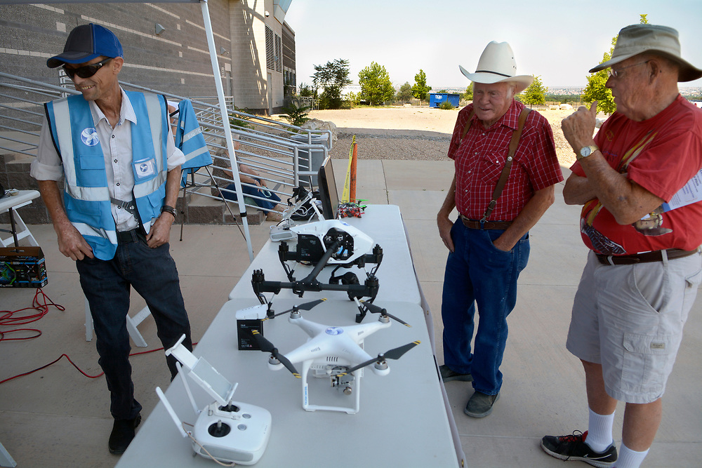 gbs062517h/ASEC - Jesse Sanson with Colibri Media House shows drones to Kenney Hall of Albuquerque and Dick Lavigne of Albuquergue, from left, during the Drone Discovery Day at the Anderson Abruzzo Albuquerque International Balloon Museum on Sunday, June 25, 2017. (Greg Sorber/Albuquerque Journal)