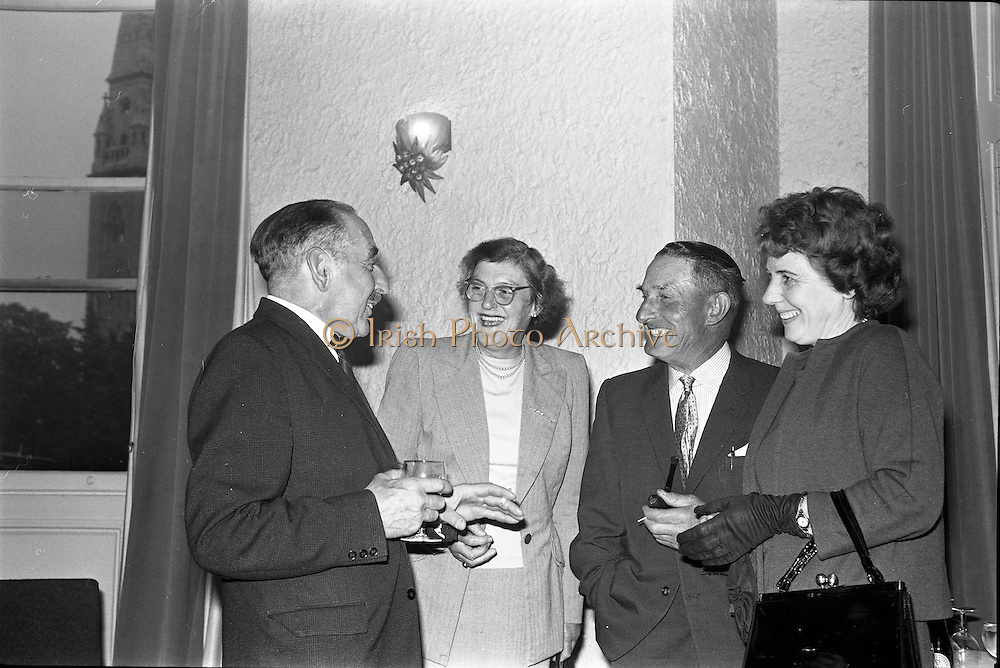 01/07/1963<br /> 07/01/1963<br /> 01 July 1963<br /> W.D. & H.O. Wills LTD., handing over trophy to Glenageary Horse Show Committee at the Royal Marine Hotel, Dun Laoghaire. A prize fund cheque of £300  and silver trophy for the winner of the Gold Flake Stakes were presented to the committee. Picture shows (l-r): Mr A.B. Martin, (Show Jumping Association of Ireland); Mrs F. Peard, (Honorary Secretary and Secretary of Phoenix Park Race Course) and Mr Rody Egan, (Course setter for the RDS and Glenageary Show) and his wife.