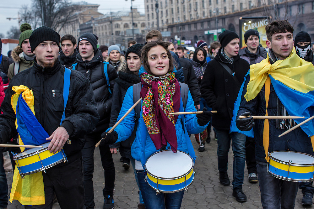 KIEV, UKRAINE - DECEMBER 5: Students march to Independence Square claiming a strike in support of anti-government protesters and in favor of tighter European integration on December 5, 2013 in Kiev, Ukraine. Thousands of people have been protesting against the government since a decision by Ukrainian president Viktor Yanukovych to suspend a trade and partnership agreement with the European Union in favor of incentives from Russia. (Photo by Brendan Hoffman/Getty Images) *** Local Caption ***