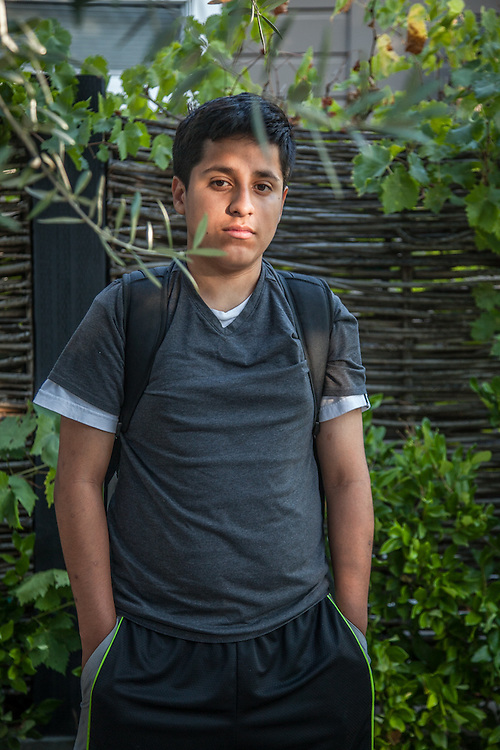 """I would like to be a photographer.""  -Fourteen year old Enrique Torres near his home in Calistoga"