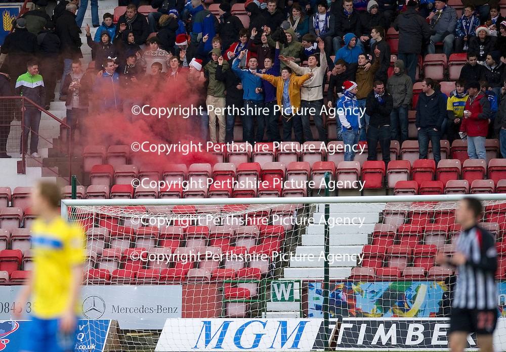 Dunfermline v St Johnstone..24.12.11   SPL <br /> St Johnstone fans set off a smoke bomb in the stands, one person was arrested.<br /> Picture by Graeme Hart.<br /> Copyright Perthshire Picture Agency<br /> Tel: 01738 623350  Mobile: 07990 594431