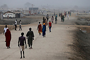 People walk on a road in the United Nations Mission in South Sudan (UNMISS) Protection of Civilian site (PoC), near Bentiu, South Sudan.