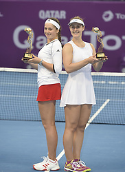 DOHA, Feb. 19, 2018  Gabriela Dabrowski (R) of Canada and Jelena Ostapenko of Latvia pose with trophy after winning the double's final match against Andreja Klepac of Slovenia and Maria Jose Martinez Sanchez of Spain at the 2018 WTA Qatar Open in Doha, Qatar, on Feb. 18, 2018. Gabriela Dabrowski and Jelena Ostapenko won 2-0 to claim the title. (Credit Image: © Nikku/Xinhua via ZUMA Wire)