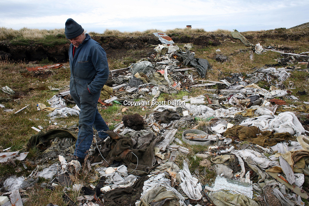 Keith Heathman walks through a junk heap of items left behind by Argentinean soldiers after the war in the Falklands, just outside of Stanley, the capital of the Falkland Islands, on Sunday, March 18, 2007. This year is the 25 anniversary of the war for sovereignty of the islands between the United Kingdom and Argentina. The two-month war resulted in the withdrawal of Argentinean forces and the islands remained part of the United Kingdom. (Photo/Scott Dalton)