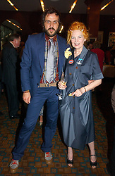 Top British fashion designer VIVIENNE WESTWOOD and her husband MR ANDREAS KRONTHALER at a party to celebrate the publication of Southwold - An Earthly Paradise by Geoffrey Munn and of Forty Years of The Antique Collectors Club at The Arts Club, 40 Dover Street, London W1 on 8th June 2006.<br />