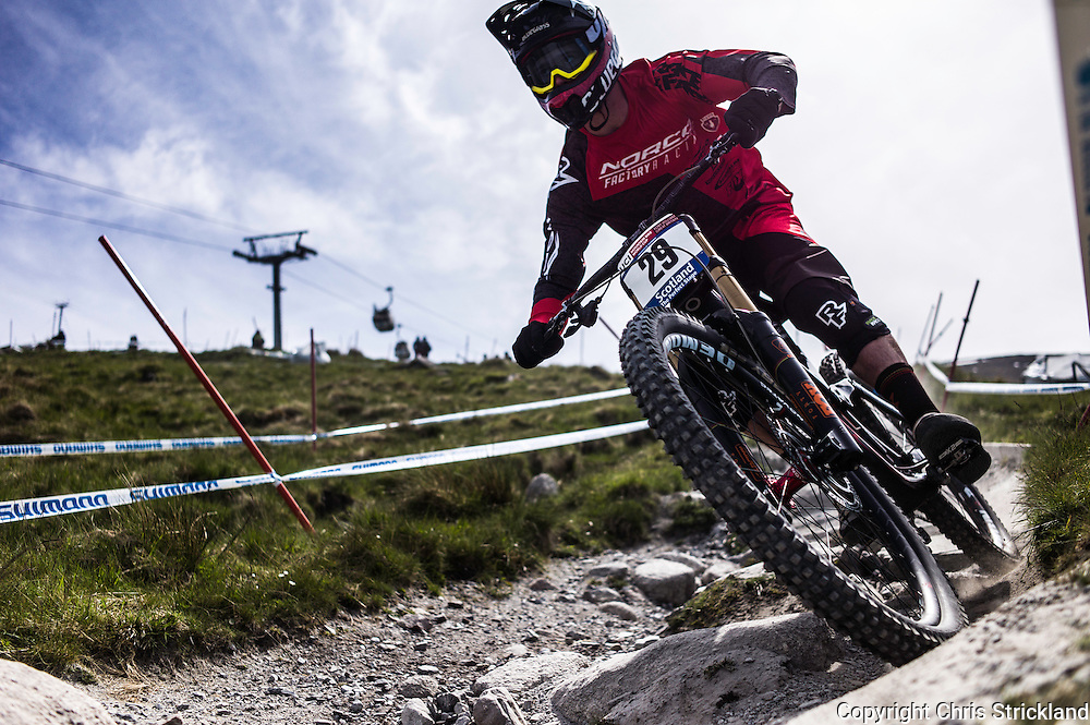 Nevis Range, Fort William, Scotland, UK. 3rd June 2016. Harry Heath of Norco Factory Racing leans into a corner. The worlds leading mountain bikers descend on Fort William for the UCI World Cup on Nevis Range.
