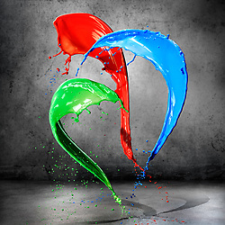 Three colours of paint splashes in motion. Red, green and Blue paint splashing shapes.