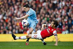 Man City Midfielder Samir Nasri (FRA) shoots as Arsenal Midfielder Mathieu Flamini (FRA) challenges him - Photo mandatory by-line: Rogan Thomson/JMP - 07966 386802 - 29/03/14 - SPORT - FOOTBALL - Emirates Stadium, London - Arsenal v Manchester City - Barclays Premier League.