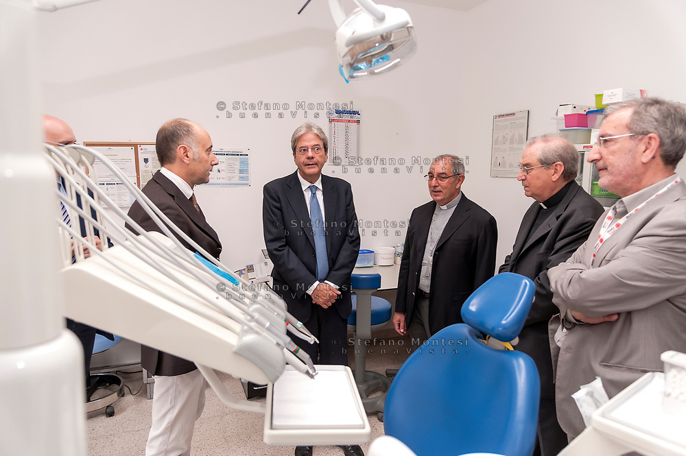 ROME, ITALY - SEPTEMBER 01: Italian PM Paolo Gentiloni with new vicar of Rome, Angelo De Donatis and the director of Caritas Rome, Msgr. Enrico Feroci during visit dental centre the Citadel of the Charity of the Diocesan Caritas of Rome on September 1, 2017 in Rome, Italy. Italian PM Paolo Gentiloni visited the Caritas to express the gratitude of all Italians to the world of volunteering, to those who work in favour of solidarity.