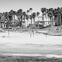 Huntington Beach panorama black and white photo. Panoramic picture ratio is 1:3. Huntington Beach is also known as Surf City USA and is a seaside beach city along the Pacific Ocean in Orange County Southern California. Image Copyright © 2012 Paul Velgos with All Rights Reserved.