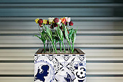 fake tulips in Delfts-blue tiled pot decoration at Schiphol airport Amsterdam