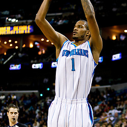 December 26, 2010; New Orleans, LA, USA; New Orleans Hornets small forward Trevor Ariza (1) shoots against the Atlanta Hawks during the first quarter at the New Orleans Arena.  Mandatory Credit: Derick E. Hingle