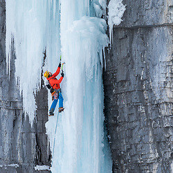 Stas Beskin ice climbing the first two pitches of the Real Big Drip as one 70m piece of ice.