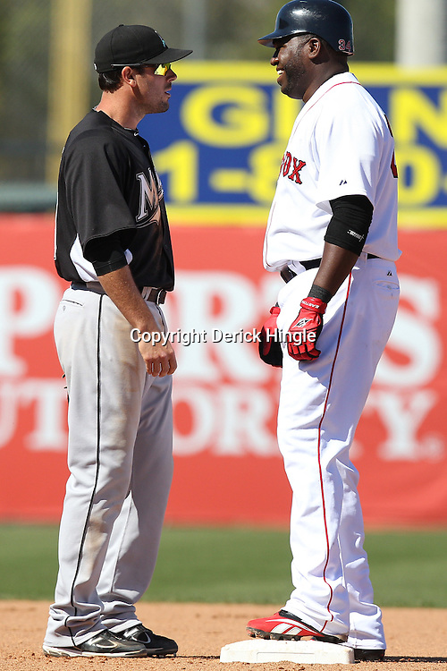 March 12, 2011; Fort Myers, FL, USA; Boston Red Sox first baseman David Ortiz (34) and Florida Marlins shortstop Donnie Murphy (22) talk during a spring training exhibition game at City of Palms Park. The Red Sox defeated the Marlins 9-2.  Mandatory Credit: Derick E. Hingle