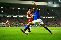 LIVERPOOL, ENGLAND - Tuesday, March 13, 2012: Liverpool's Martin Kelly in action against Everton's Sylvain Distinc during the Premiership match at Anfield. (Pic by David Rawcliffe/Propaganda)