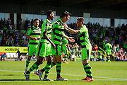 Kieffer Moore (14) of Forset Green Rovers celebrates scoring a goal to make the score 1-0 with Ethan Pinnock (16) of Forset Green Rovers and Elliott Frear (11) of Forset Green Rovers during the Vanarama National League match between Forest Green Rovers and Southport at the New Lawn, Forest Green, United Kingdom on 29 August 2016. Photo by Graham Hunt.