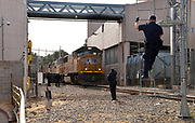 U.S. customs inspectors monitor a Union Pacific freight train carrying goods from Mexico as it crosses from Nogales, Sonora, Mexico, in to Nogales, Arizona, USA, at the DeConcini Customs Inspection Station as part of NAFTA or the North American Free Trade Agreement.