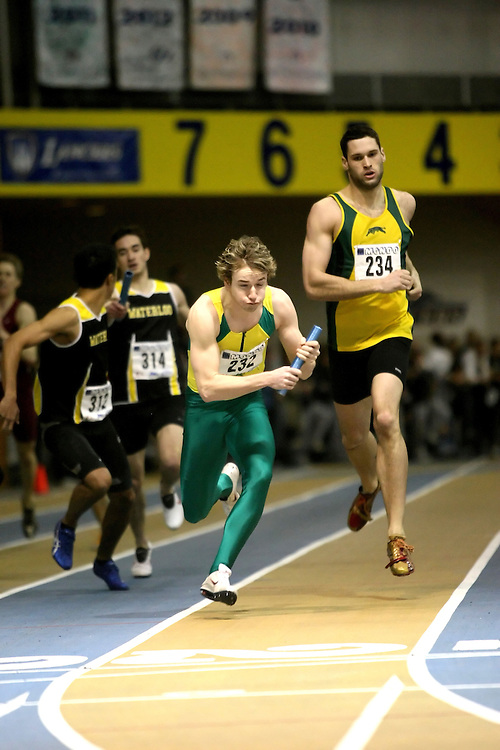 Windsor, Ontario ---14/03/09--- \cisLeslie Andersen of  the University of Regina (232) and Eric Clark of  the University of Regina (234)\ competes in the Men's 4x400m Relay at the CIS track and field championships in Windsor, Ontario, March 14, 2009..Sean Burges Mundo Sport Images