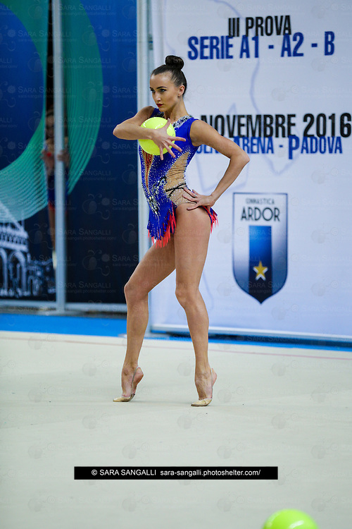 PADUA, ITALY - NOVEMBER 12 2016: Anna Rizatdinova of San Giorgio Desio performs with ball at the italian national rhythmic gymnastic championship. Her score in the apparatus is 18,750. Her team's score is 103,450 and ended up in first position.