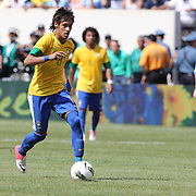 Neymar, Brazil, in action watched by Lionel Messi, Argentina, (right)  during the Brazil V Argentina International Football Friendly match at MetLife Stadium, East Rutherford, New Jersey, USA. 9th June 2012. Photo Tim Clayton