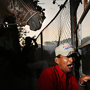 """A man cheers on cowboys as they compete in a lasso competition in San Carlos, near Boquete, Panama, on February 11, 2007. In the competition, each heat features one town's team versus another in a tournament bracket style. The speed of the calf's capture determines points. ..""""Cheer On"""""""