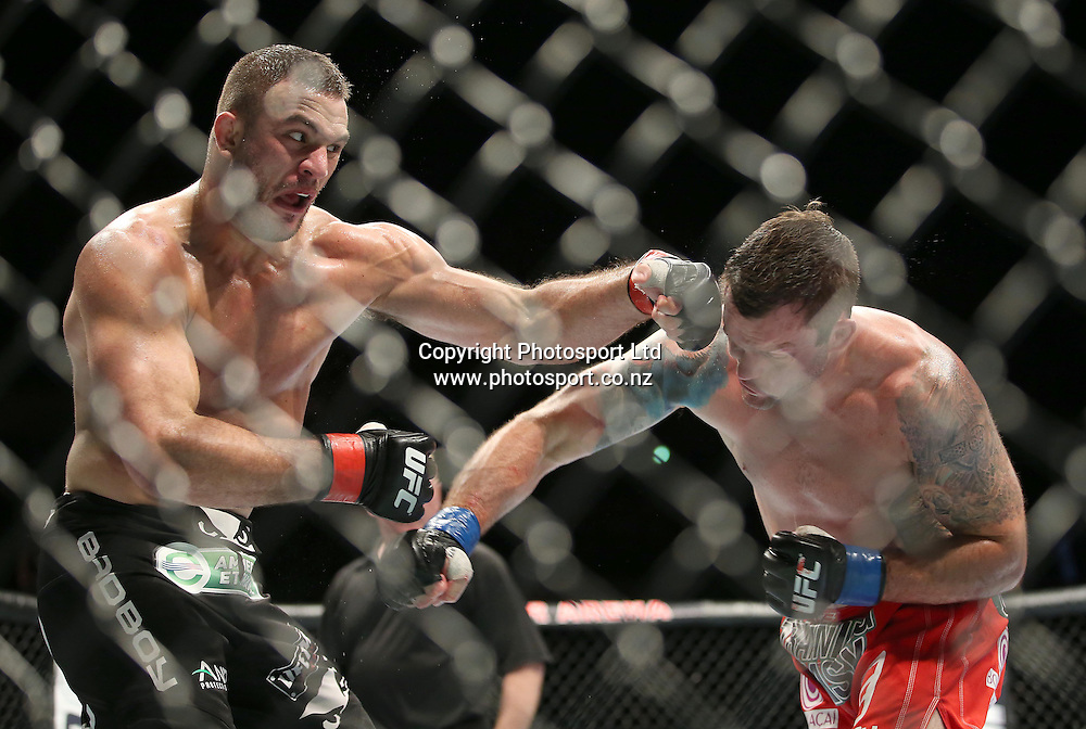 Gian Villante, left, battles with Sean O'Connell during the UFC Ultimate Fighting Championship fight night held at Vector Arena in Auckland on Saturday 28th of July 2014. <br /> Credit; Peter Meecham/ www.photosport.co.nz