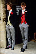 Schoolboys at Eton College boarding school  in traditional waistcoats and tailcoats, Berkshire, UK.