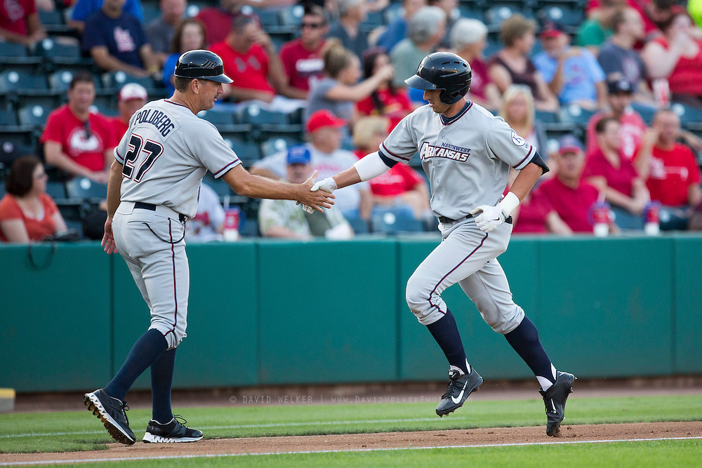 Lane Adams (8) of the Northwest Arkansas Naturals shakes hands with Brian Poldberg (27) as he rounds the bases after hitting a home run during a game against the Springfield Cardinals at Hammons Field on August 20, 2013 in Springfield, Missouri. (David Welker)