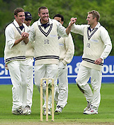 Shenley, Middlsex. ENGLAND, Sri Lanka Tour match.<br /> Photo Peter Spurrier<br /> 11/05/2002 Card - 1<br /> Sport - Cricket<br /> Middlesex CCC vs Sri Lankas - Shenley<br /> Aaron Laraman centre is concratulated by his team mates.                             [Mandatory Credit:Peter SPURRIER/Intersport Images]
