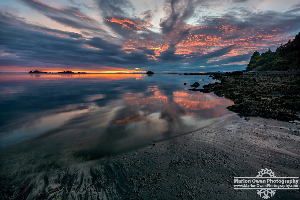 Sunrise and reflections at low tide in Chiniak Bay, Kodiak, Alaska, autumn, Southwest Alaska