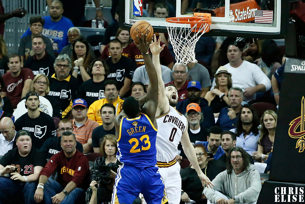 09 June 2017: Golden State Warriors forward Draymond Green (23) goes for the jump shot over Cleveland Cavaliers forward Kevin Love (0) during the Cleveland Cavaliers 137-11 victory over the Golden State Warriors, in game 4 of the 2017 NBA Finals, at  the Quicken Loans Arena, Cleveland, Ohio, USA.