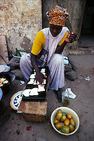 women cooking street food, Dakar
