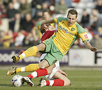 Photo: Aidan Ellis.<br /> Barnsley v Norwich City. Coca Cola Championship. 03/03/2007.<br /> Norwich's Darren Huckerby is tackled by Barnsley's Brian Howard