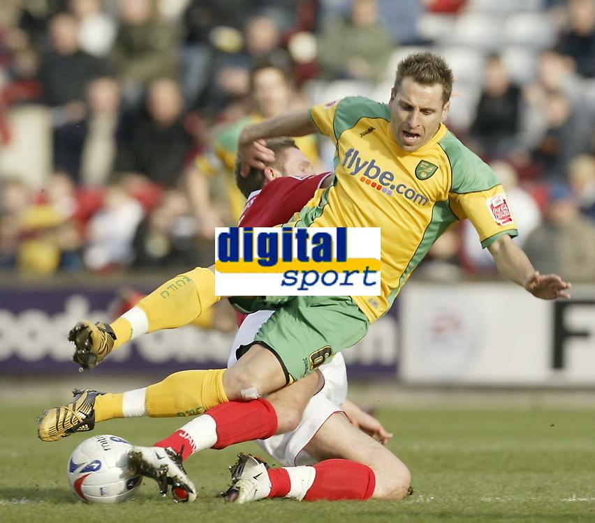Photo: Aidan Ellis.<br /> Barnsley v Norwich City. Coca Cola Championship. 03/03/2007.<br /> Norwich's Darren Huckerby is tackled by Barnsley's Brian Howard