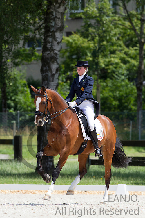 Laurence Roos - Ambaro Saturnus<br /> FEI European Championships Dressage Juniors and Young Riders 2012<br /> © DigiShots
