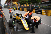 Marshals move an F3 car<br /> 64th Macau Grand Prix. 15-19.11.2017.<br /> Suncity Group Formula 3 Macau Grand Prix - FIA F3 World Cup<br /> Macau Copyright Free Image for editorial use only
