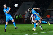Charlie Raglan (5) of Cheltenham Town heads the ball clear during the EFL Sky Bet League 2 match between Exeter City and Cheltenham Town at St James' Park, Exeter, England on 16 November 2019.