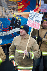 © Licensed to London News Pictures.  09/12/2014. AYLESBURY, UK. Thousands of fire fighters march through Aylesbury during the latest  nationwide strike of Fire Brigade Union members over pension rights. the union is also intending to take legal action over the dismissal of Ricky Matthews by the Buckinghamshire and Milton Keynes Fire Authority for taking part in pervious industry action.<br /> <br /> Photo credit: Cliff Hide/LNP