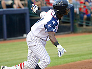 July 5, 2017 - Trenton, New Jersey, U.S - JORGE MATEO of the Yankees' double-A affiliate Trenton Thunder doubles in third inning of the game at ARM & HAMMER Park tonight vs. the Fightin Phils. The Thunder were wearing patriotic jerseys for the July 4th and 5th games. (Credit Image: © Staton Rabin via ZUMA Wire)