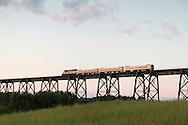 Cornwall, New York - A Metro North passenger train crosses the Moodna  Viaduct railroad trestle on July 24, 2015. The bridge was constructed between 1904 and 1908 by the Erie Railroad and was opened for service in January 1909. The steel structure is the highest and longest railroad trestle east of the Mississippi River.