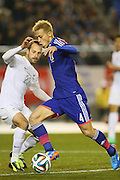 Keisuke Honda (JPN) gets past Andrew Durante (NZL), <br /> MARCH 5, 2014 - Football /Soccer : <br /> Kirin Challenge Cup 2014<br /> between Japan 4-2 New Zealand <br /> at National Stadium, Tokyo, Japan. <br /> (Photo by YUTAKA/AFLO SPORT)