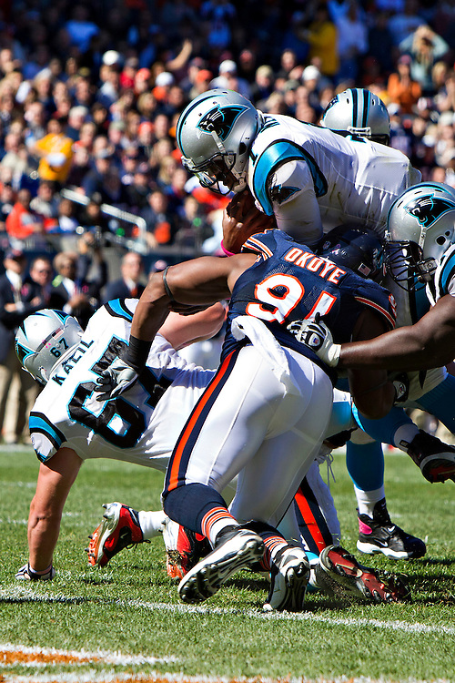 CHICAGO, IL - OCTOBER 2:   Cam Newton #1 of the Carolina Panthers tries to jump over the line into the end zone during a game against the Chicago Bears at Soldier Field on October 2, 2011 in Chicago, Illinois.  The Bears defeated the Panthers 34 to 29.  (Photo by Wesley Hitt/Getty Images) *** Local Caption *** Cam Newton