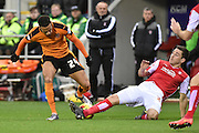Rotherham United defender Lewis Buxton sliding tackel on Wolverhampton Wanderers midfielder Jordan Graham during the Sky Bet Championship match between Rotherham United and Wolverhampton Wanderers at the New York Stadium, Rotherham, England on 5 December 2015. Photo by Ian Lyall.