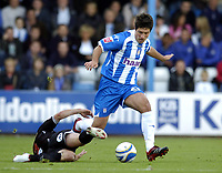Photo: Olly Greenwood.<br />Colchester United v West Bromwich Albion. Coca Cola Championship. 20/10/2007. Colchester's Kem Izzett goes past West Brom's Paul Robinson